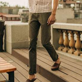 fit model wearing The Slim All Day Pant in Olive Bedford Cord, walking down steps