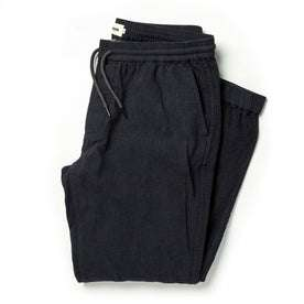 folded flatlay of The Après Pant in Coal Double Cloth
