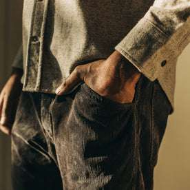 our fit model wearing The Camp Pant in Charcoal Corduroy—cropped shot, hand in pocket