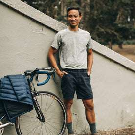 our fit model wearing The Merino Tee—in our grey colorway with his bike