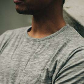our fit model wearing The Merino Tee—in the grey colorway, cropped shot of chest