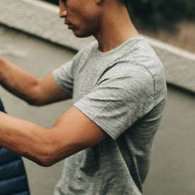 our fit model wearing The Merino Tee—in our grey colorway, cropped shot of shoulder