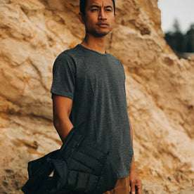 our fit model wearing The Merino Tee—in our navy colorway on the coast