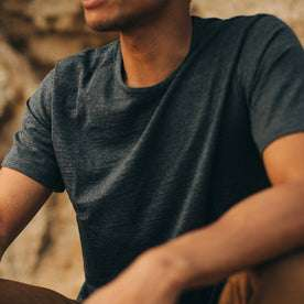 our fit model wearing The Merino Tee—in our navy colorway, cropped shot of chest