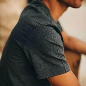our fit model wearing The Merino Tee—in our navy colorway, cropped shot of shoulder