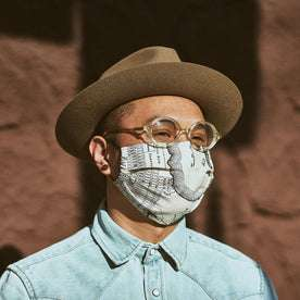 our fit model wearing The Pleated Mask in SF Map Print—cropped shot of face looking right