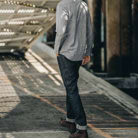 our fit model wearing The Slim Everyday Jean—cropped shot of model walking ahead