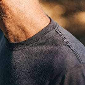 our fit model wearing The Standard Issue Tee in Navy Hemp—cropped shot of shoulder and collar