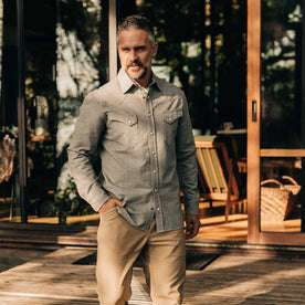 our fit model wearing The Western Shirt in Olive Melange—on a deck, hand in pocket