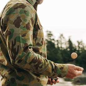 our fit model wearing The Yosemite Shirt in Arid Camo—cropped shot of shoulder
