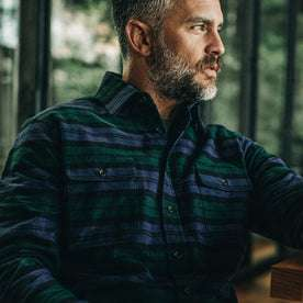 our fit model wearing The Yosemite Shirt in Blackwatch Plaid—sitting, cropped shot