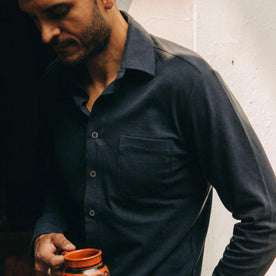 fit model wearing The California in Navy Pique, holding mug, looking down