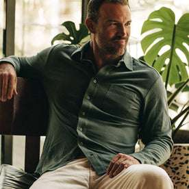 fit model wearing The California in Sea Green Pique, sitting, looking right