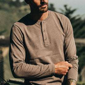 fit model wearing The Heavy Bag Henley in Espresso, cropped nose down