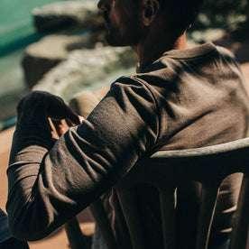 fit model wearing The Heavy Bag Henley in Espresso, sleeve detail
