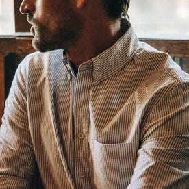 fit model wearing The Jack in Navy University Stripe Everyday Oxford, cropped chest shot
