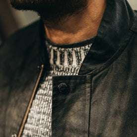 fit model wearing The Bomber Jacket in Black Dry Wax, button close up