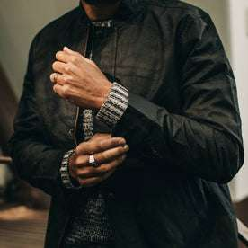 fit model wearing The Bomber Jacket in Black Dry Wax, sleeve