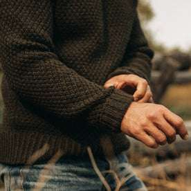 fit model wearing The Fisherman Sweater in Loden, sleeve shot