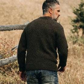 fit model wearing The Fisherman Sweater in Loden, back shot