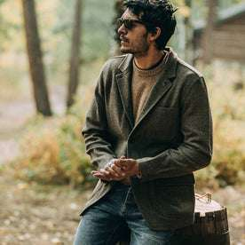 fit model wearing The Gibson Jacket in Olive Herringbone Wool, hands clasped