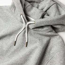 material shot of The Heavy Bag Hoodie in Heather Grey Fleece with pull hoodie drawstrings closeup