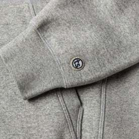 material shot of The Heavy Bag Hoodie in Heather Grey Fleece's ribbed cuff with TS logo embroidery