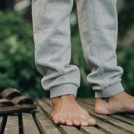 our fit model wearing The Heavy Bag Pant in Heather Grey Fleece closeup of ankle cuffs