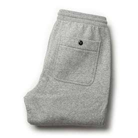 flatlay of The Heavy Bag Pant in Heather Grey Fleece from the back with back pocket shown