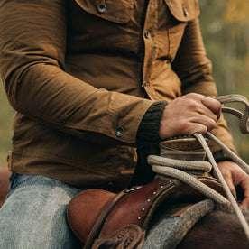 fit model wearing The Lined Long Haul Jacket in Harvest Tan Dry Wax, sleeve