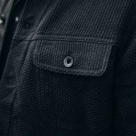 fit model wearing The Long Haul Jacket in Black Indigo Sashiko—cropped shot of chest button