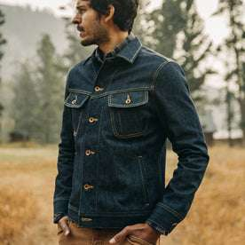 fit model wearing The Long Haul Jacket in Cone Mills Reserve Selvage, looking left