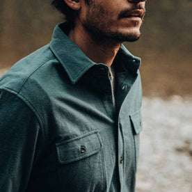 fit model wearing The Yosemite Shirt in Deep Ocean—looking right, cropped