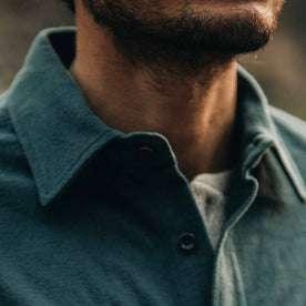 fit model wearing The Yosemite Shirt in Deep Ocean—cropped collar shot