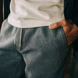 fit model wearing The Après Pant in Charcoal Waffle, close up shot of fabric