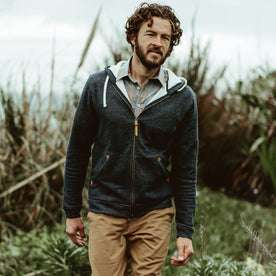 Our fit model wearing The Après Hoodie in Navy from Taylor Stitch.