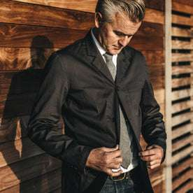 Our fit model in the Gibson jacket in charcoal at a wedding.