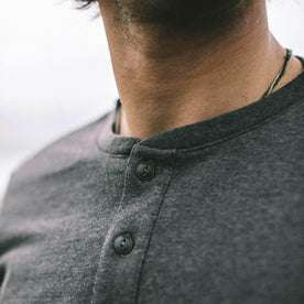 Our fit model wearing The Heavy Bag Henley in Heather Grey