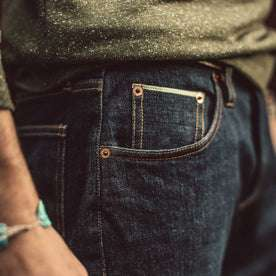 Material shot.Our fit model wearing The Democratic Jean in Organic Stretch Selvage.