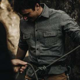 The fit model wearing Yosemite Shirt in Heather Charcoal and getting ready to climb