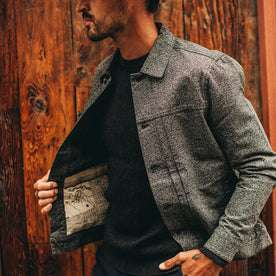 fit model wearing flatlay of The Dispatch Jacket in Navy Jaspe, holding right pocket