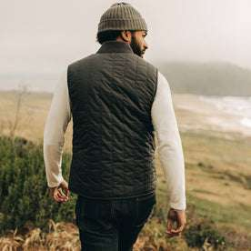 fit model wearing The Able Vest in Quilted Charcoal, back shot