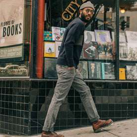 fit model wearing The Camp Pant in Navy Jaspe, walking right
