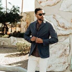 our fit model wearing The Gibson Jacket in Navy—looking right