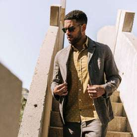 our fit model wearing The Gibson Jacket in Gravel—walking down stairs