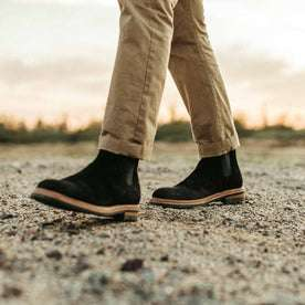 our fit model wearing The Ranch Boot in Coal Weatherproof Suede—walking left of screen