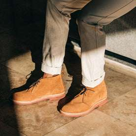 our fit model wearing The Unlined Chukka in Butterscotch Weatherproof Suede—pants cuffed with strong shadows on floor