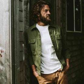 our fit model wearing The Long Haul Jacket in Washed Olive Herringbone