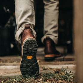our fit model wearing The Moto Boot in Chocolate Pebble Grain—shot of vibram sole