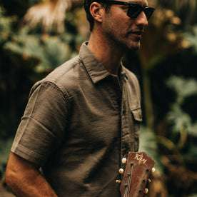 our fit model wearing The Caravan Shirt in Walnut Double Cloth—walking right, cropped shot